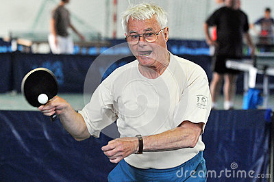 Grandfather senior plays table tennis Editorial Image
