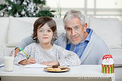 Grandfather And Son With Envelope