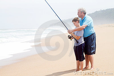 Grandfather teaching grandson fishing