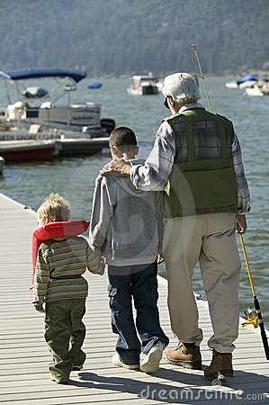 Grandfather and two grandsons on pier