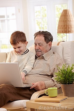 Grandfather using computer at home