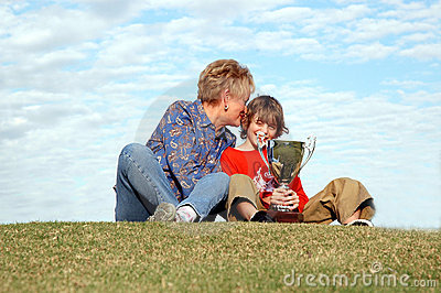 Grandma and boy with trophy