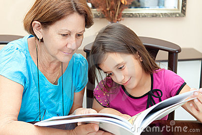 Grandma and girl reading a book
