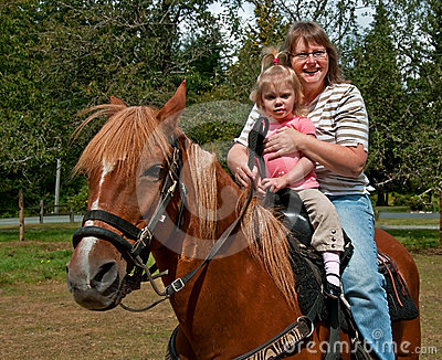 Grandma and Granddaughter Horse Riding