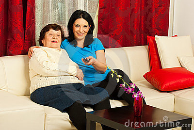 Grandma and granddaughter wath tv