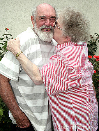 Grandma kissing grandpa