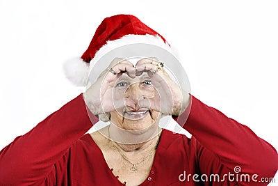 Grandma making heart symbol