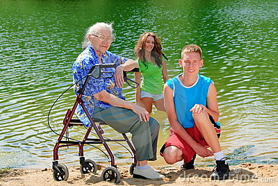 Grandma and teens by lake