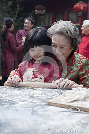 Free Grandmother And Granddaughter Making Dumplings In Traditional Clothing Stock Images - 33394274