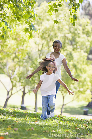 Free Grandmother And Granddaughter Running In Park And Royalty Free Stock Images - 5469779