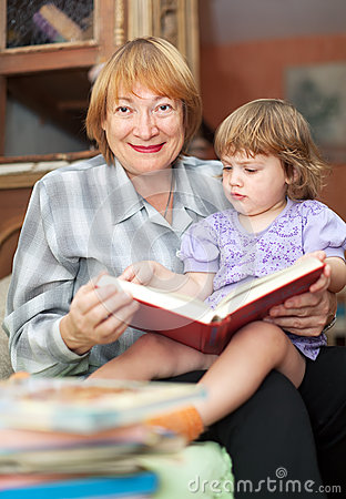Grandmother and baby reading book