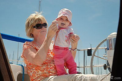 Grandmother and baby on a sailboat