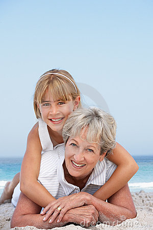Grandmother On Beach With Granddaughter