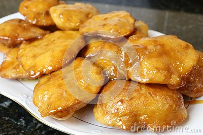 Grandmother cakes a homemade sweet fried with honey