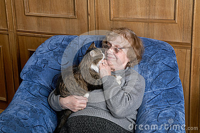 The grandmother with a cat in house
