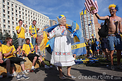Grandmother dances with swedish football fans Editorial Stock Image