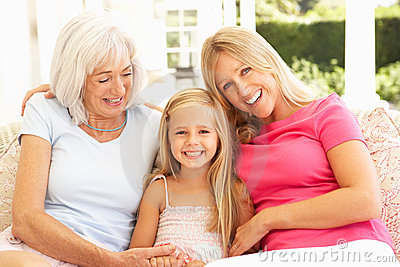 Grandmother, Daughter And Granddaughter Relaxing