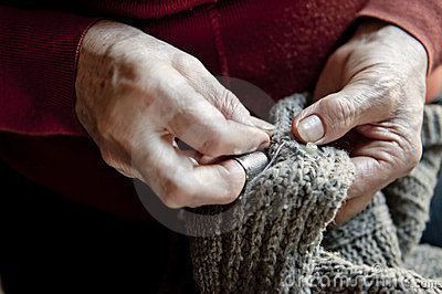 Grandmother fixing a sweater