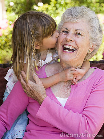 Free Grandmother Getting A Kiss From Granddaughter Stock Photos - 5466683