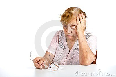 The grandmother with glasses in hands