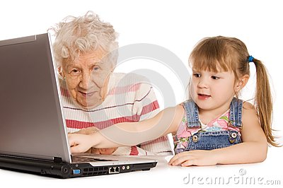 Grandmother with grand daughter at the computer
