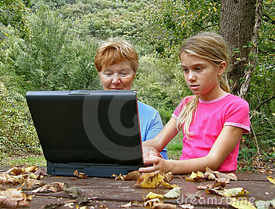 Grandmother and grandaughter with laptop