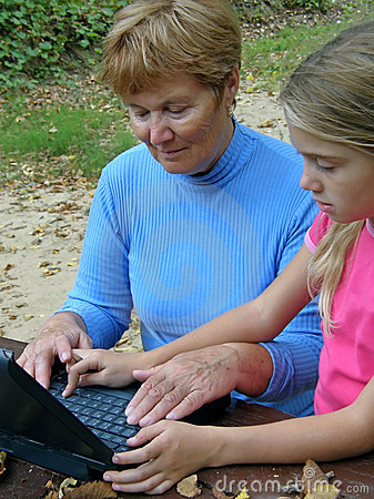 Grandmother, grandchild with laptop
