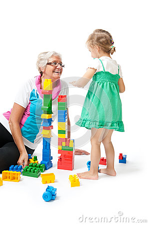 Grandmother with grandchildren playing with blocks