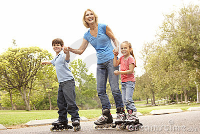 Grandmother And Grandchildren Skating In Park