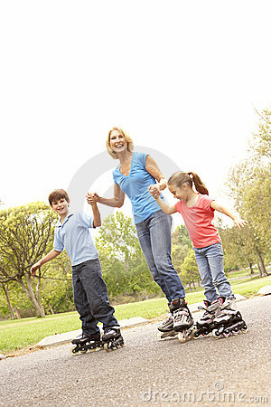 Grandmother And Grandchildren Skating In Park Stock Photos - Image: 11502133