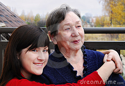 Grandmother  and granddaughter  on a balcony