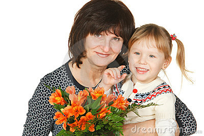 Grandmother and granddaughter with bunch of flower