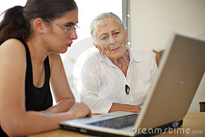 Grandmother and granddaughter at copmuter