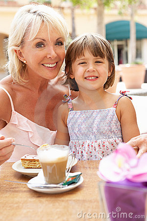 Grandmother With Granddaughter Enjoying Coffee