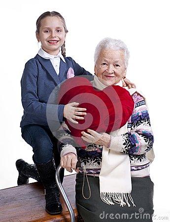 Grandmother with granddaughter holding heart pillow