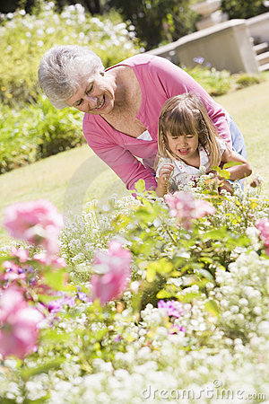 Grandmother and granddaughter outdoors in garden