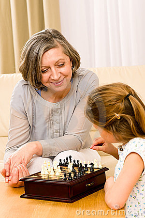 Grandmother and granddaughter play chess together