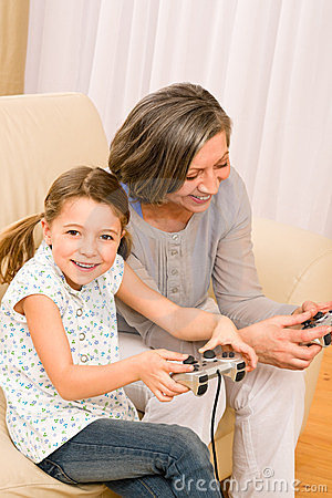 Grandmother and granddaughter play computer game