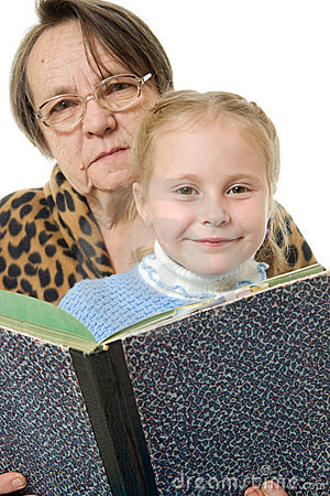 Grandmother granddaughter reading a book