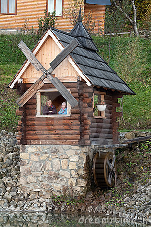 Grandmother and granddaughter in wooden house