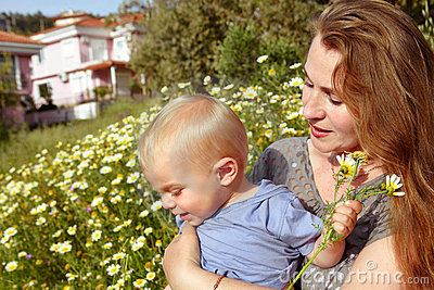 Grandmother and grandson in daisies field