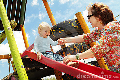 Grandmother and grandson on the playground
