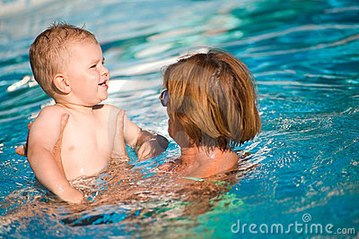 Grandmother and grandson swim