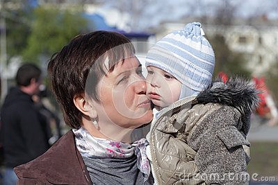 Grandmother kissing toddler