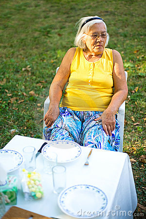 Grandmother at lunch table