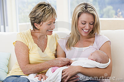 Grandmother and mother in living room with baby