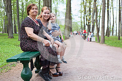 Grandmother, mother and small daughter in the park