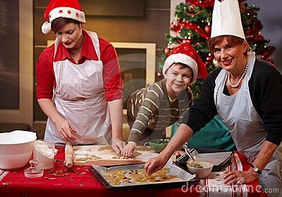 Grandmother, mum and son with christmas cake