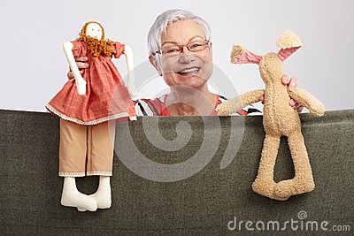 Grandmother presenting a puppet show