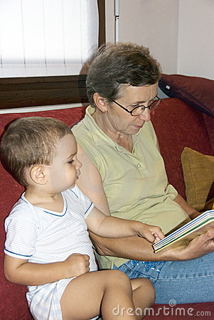 Grandmother reading book to baby